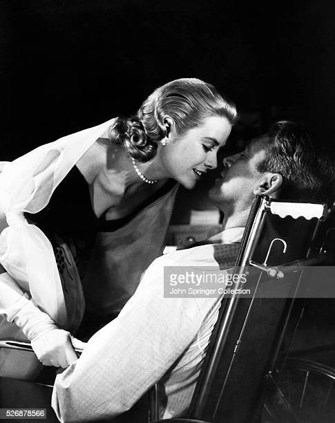 Lisa Carol Fremont leans in to kiss LB Jeffries in a scene from the classic 1954 Alfred Hitchcock film Rear Window
