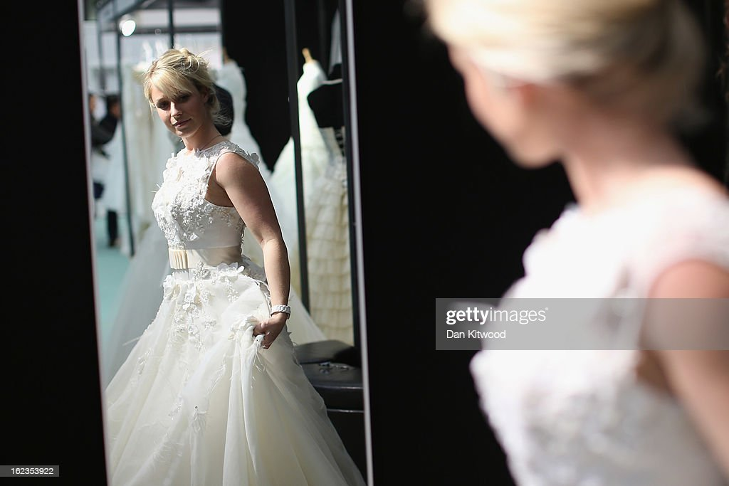 Lisa Chle Tries On A Wedding Dress During The National Show At London S Olympia