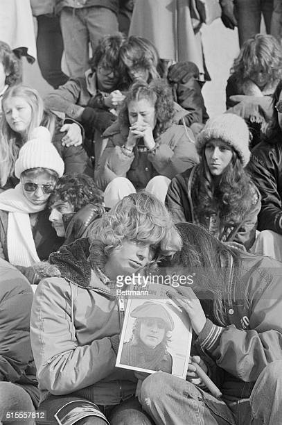 Lisa Conklin and Diana Gerbec both from Columbus attended the memorial rally for John Lennon and here observe the ten minutes of silence requested by...