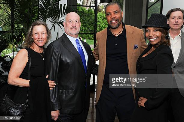 Lisa Curtis Bill Curtis actor Eriq La Salle and a guest attend Jeremy Renner's and Kristoffer Winters' celebration of the launch of Robb Report Home...