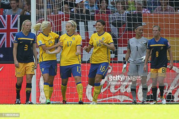 Lisa Dahlkvist of Sweden celebrates the second goal with Josefine Oqvist and Linda Forsberg of Sweden during the FIFA Women's World Cup 2011 Quarter...