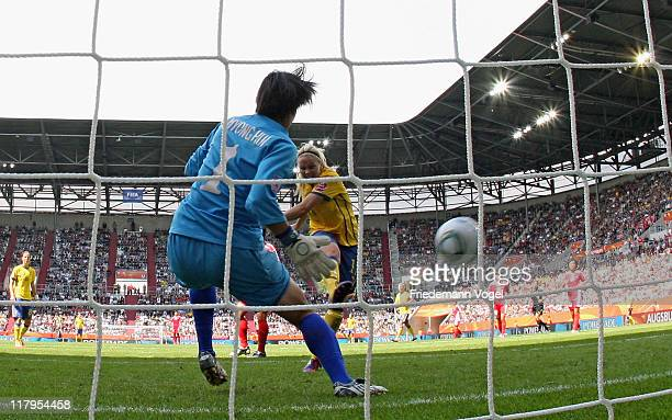 Lisa Dahlkvist of Sweden scores her team's first goal during the FIFA Women's World Cup 2011 Group C match between North Korea and Sweden at FIFA...