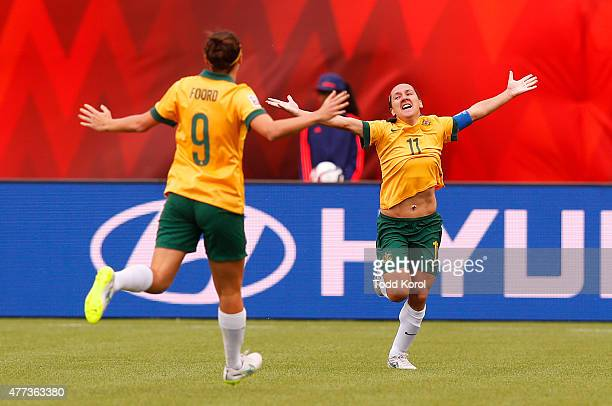 Lisa De Vanna celebrates her goal with teammate Caitlin Foord of Australia during the FIFA Women's World Cup Canada Group D match between Australia...