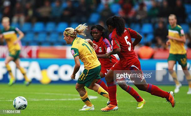 Lisa de Vanna of Australia and Ana Cristina of Equatorial Guinea battle for the ball during the FIFA Women's World Cup 2011 Group D match between...