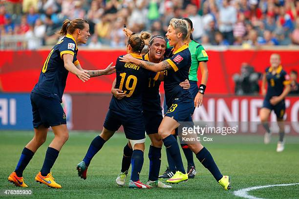 Lisa De Vanna of Australia celebrates her first half goal with teammates against the United States during the FIFA Women's World Cup 2015 Group D...