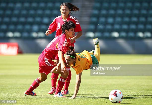 Lisa De Vanna of Australia is tackled by Shanshan Wang of China during the match between the Australian Matildas and China PR at WIN Stadium on...