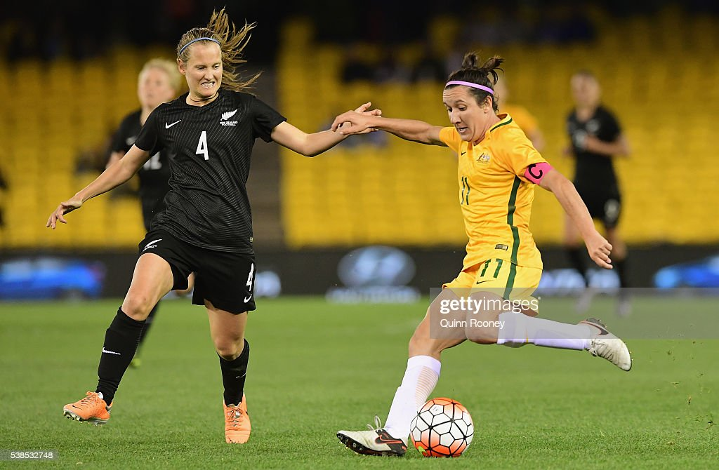 Lisa De Vanna of Australia passes infront of Katie Duncan of New Zealand during the Women's International Friendly match between the Australia Matildas and the New Zealand Football Ferns at Etihad Stadium on June 7, 2016 in Melbourne, Australia.