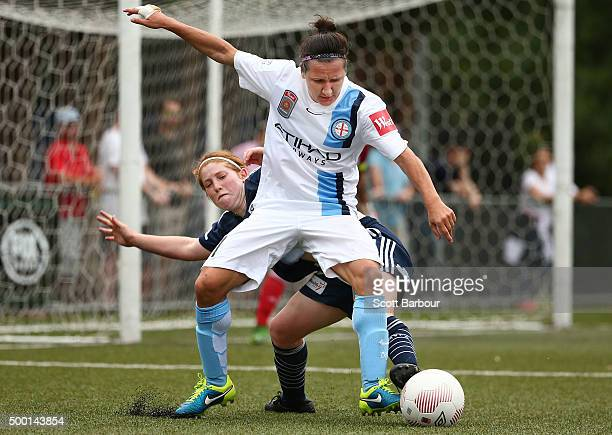 Lisa De Vanna of City and Annabel Martin of the Victory compete for the ball during the round eight WLeague match between the Melbourne Victory and...