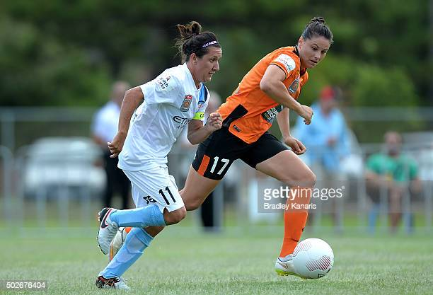Lisa De Vanna of Melbourne City breaks away from the defence of Emily Gielnik of the Roar during the round 11 WLeague match between Brisbane Roar and...