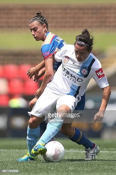Lisa De Vanna of Melbourne City contests the ball with Chloe Logarzo of the Jets during the round nine WLeague match between the Newcastle Jets and...