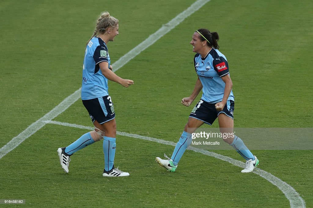 Lisa De Vanna of Sydney FC and Remy Siemsen of Sydney FC celebrate victory at the end of the W-League semi final match between Sydney FC and the Newcastle Jets at Leichhardt Oval on February 10, 2018 in Sydney, Australia.