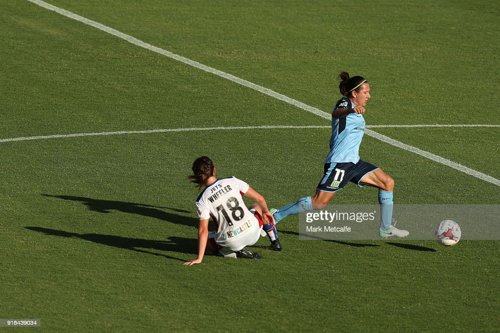 Lisa De Vanna of Sydney FC is tackled by Clare Wheeler of Newcastle Jets during the W-League semi final match between Sydney FC and the Newcastle Jets at Leichhardt Oval on February 10, 2018 in Sydney, Australia.