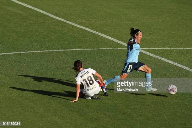 Lisa De Vanna of Sydney FC is tackled by Clare Wheeler of Newcastle Jets during the WLeague semi final match between Sydney FC and the Newcastle Jets...
