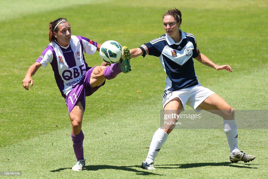 Lisa De Vanna of the Glory and Danielle Johnson of the Victory contest for the ball during the W-League Semi Final match between Perth Glory and Melbourne Victory at nib Stadium on January 20, 2013 in Perth, Australia.