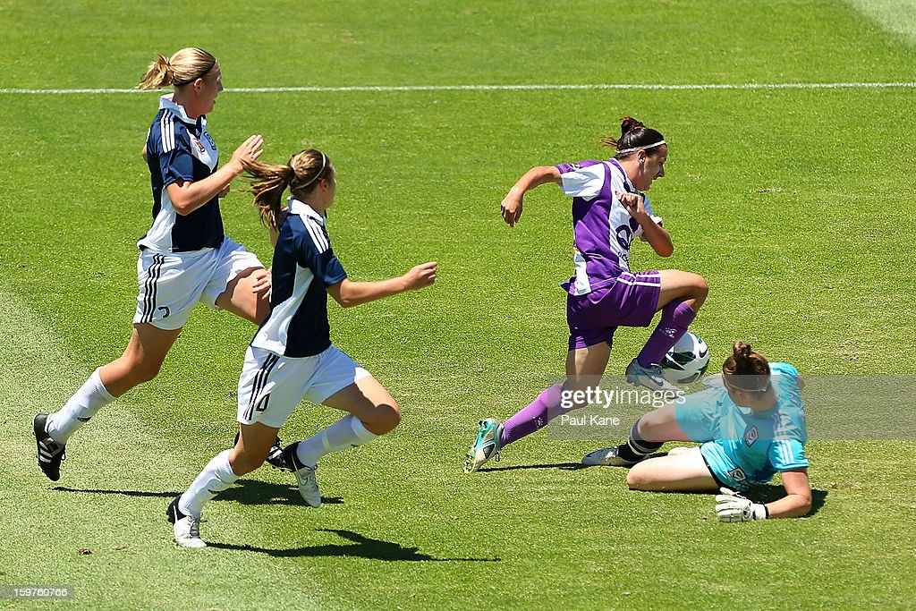 Lisa De Vanna of the Glory is challenged by Brianna Davey of the Victory contest for the ball during the W-League Semi Final match between Perth Glory and Melbourne Victory at nib Stadium on January 20, 2013 in Perth, Australia.