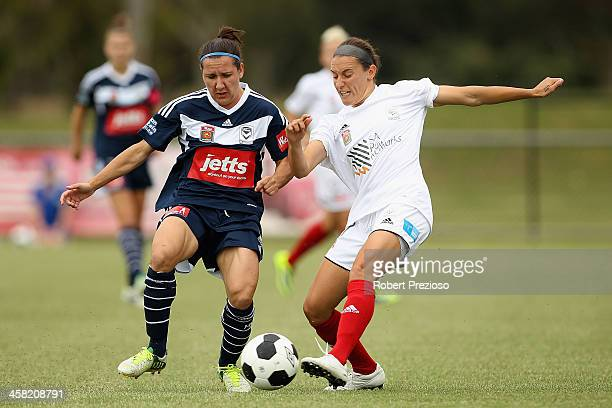 Lisa De Vanna of the Victory and Snez Veljanovska of Adelaide contest the ball during the round six WLeague match between the Melbourne Victory and...