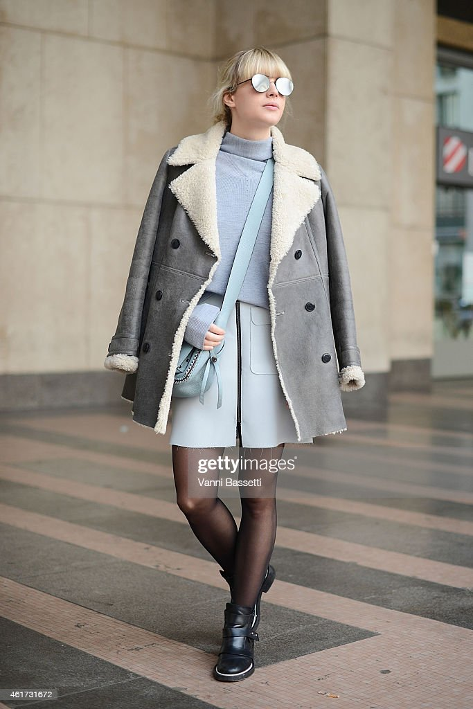 Lisa Dengler poses wearing a Tommy Hilfiger coat, Reiss sweater, Coach bag and Maje shoes during day 2 of Milan Menswear Fashion Week Fall/Winter 2015/2016 on January 18, 2015 in Milan, Italy.