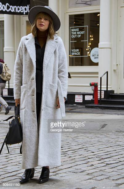 Lisa Dengler seen at The Apartment by The Line outside the Protagonist presentation wearing Won Hundred light grey full length coat, Lack Of Color...