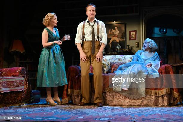 Lisa Dillon as Ruth, Emma Naomi as Elvira and Geoffrey Streatfield as Charles in Noel Coward's Blithe Spirit directed by Richard Eyre at The Duke Of...