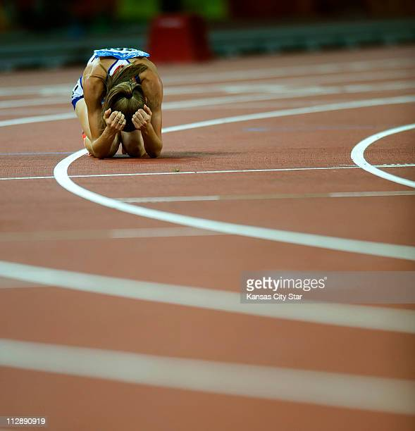 Lisa Dobriskey of Great Britain reacts after finishing fourth in the 1500 meters final on Saturday August 23 in the Games of the the XXIX Olympiad in...