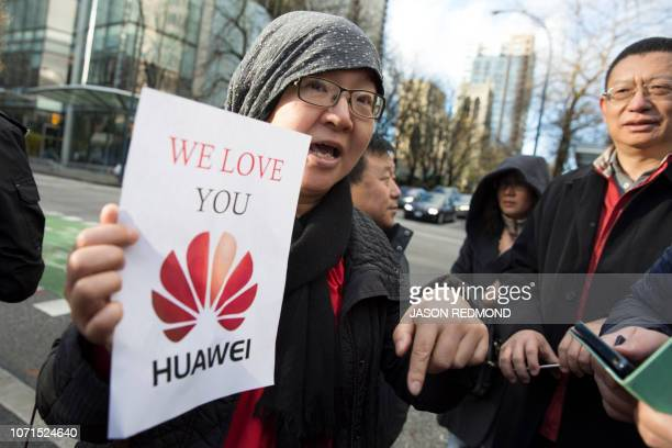 Lisa Duan visiting from Beijing holds a proHuawei sign outside the bail hearing of Huawei Technologies Chief Financial Officer Meng Wanzhou at...
