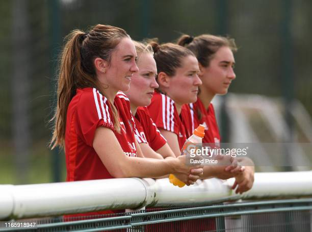 Lisa Evans and Kim Little of Arsenal Women stop to watchduring the match between Arsenal U23 and Watford XI at London Colney on August 03 2019 in St...