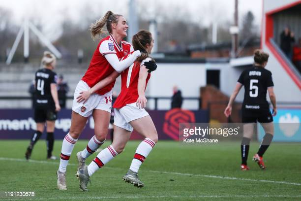 Lisa Evans of Arsenal celebrates with with Jill Roord after scoring her sides ninth goal during the Barclays FA Women's Super League match between...