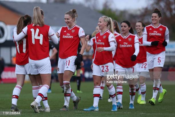 Lisa Evans of Arsenal celerbates with her team mates after scoring her sides ninth during the Barclays FA Women's Super League match between Arsenal...