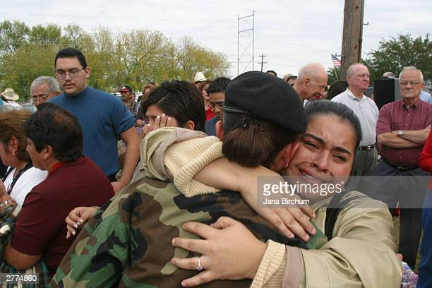 Lisa Garcia hugs her cousin, Spc. Rebecca Vasquez during an emotional send-off ceremony for the San Marcos Army Reserve 13th Corps Support Command...