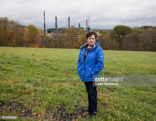 Lisa Graves-Marcucci, a community outreach employee of the Environmental Integrity Project, stands on private farmland opposite a natural gas...