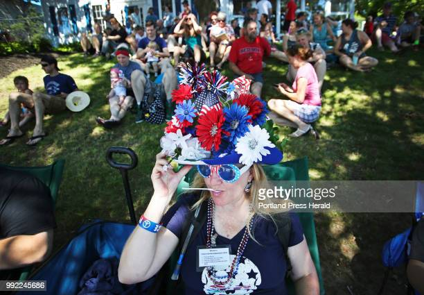 Lisa Green aka The Crazy Hat Lady of Brunswick pauses while enjoying strawberry ice cream to adjust her handmade Independence Day hat Lisa who has...