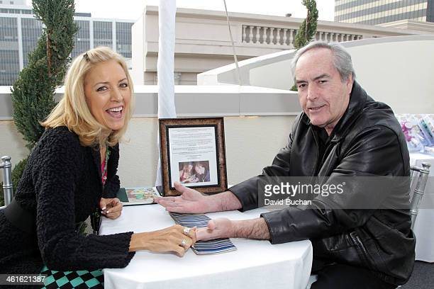 Lisa Greenfield and Powers Boothe attend the DPA PreGolden Globe Awards Gift Suite at the Luxe Hotel on January 9 2014 in Beverly Hills California