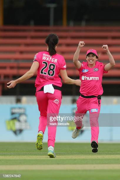 Lisa Griffith of the Sixers celebrates with Jodie Hicks of the Sixers after taking the wicket of Madeline Penna of the Strikers during the Women's...