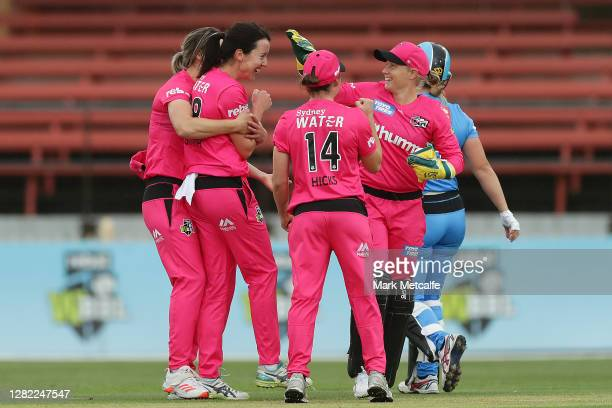 Lisa Griffith of the Sixers celebrates with team mates after taking the wicket of Madeline Penna of the Strikers during the Women's Big Bash League...