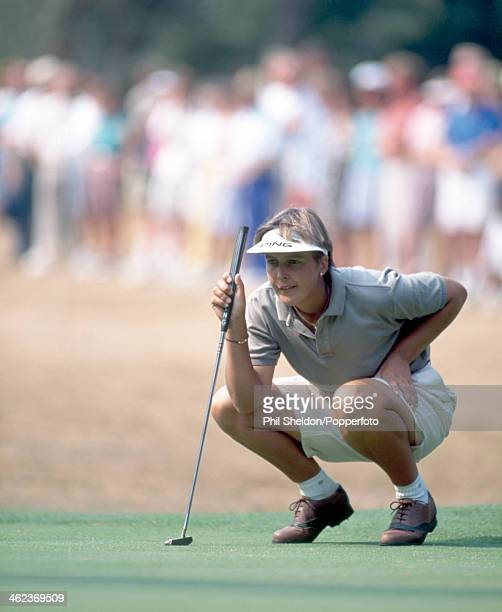 Lisa Hackney of Great Britain lines up a putt during the Women's British Open Golf Championship held at the Woburn Golf and Country Club in Milton...