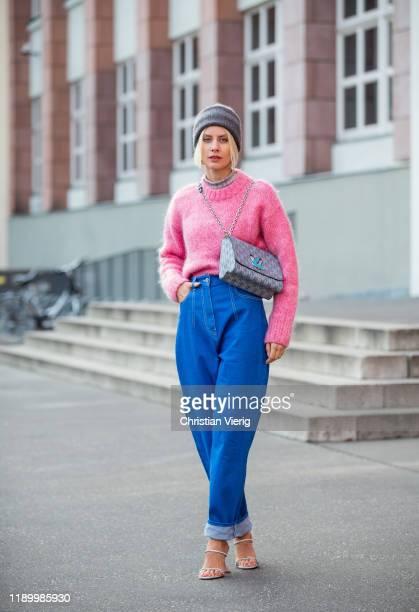 Lisa Hahnbück is seen wearing grey Arket beanie, pink H&M trend knit, high waist dark denim jeans Louis Vuitton FW19, Amina Muaddi Gilda heels, Louis...