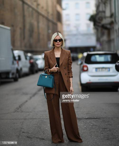 Lisa Hahnbück wearing a Hermes bag and a brown blazer and pants outside Max Mara during Milan Fashion Week Fall/Winter 20202021 on February 19 2020...