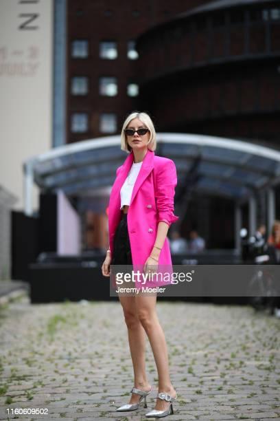 Lisa Hahnbück wearing Attico Blazer Jimmy Choo Shoes Prada shorts Livin Cool shirt on July 01 2019 in Berlin Germany