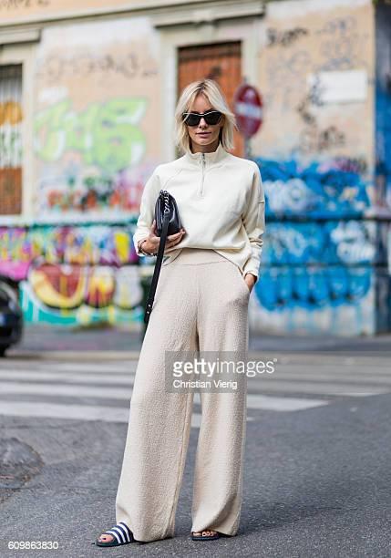 Lisa Hahnbeuck wearing an Athleisure Look Reebock sweater Knit Pants Molli sunglasses Givenchy Adiletten Chanel Boy Bag outside Fendi during Milan...