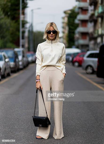 Lisa Hahnbeuck wearing an Athleisure Look Reebock sweater Knit Pants Molli sunglasses Givenchy Adiletten Chanel Boy Bag outside Fendi during Milan...