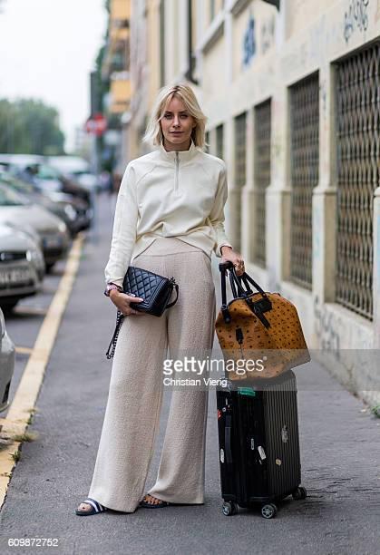 Lisa Hahnbeuck wearing an Athleisure Look Reebock sweater Knit Pants Molli bag Rimowa and MCM Nomad Travel Bag Adiletten Chanel Boy Bag outside Fendi...