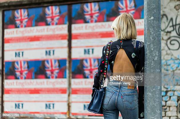Lisa Hahnbeuck wearing Lala Berlin Backless Cropped Silk Top with Long Sleeves jeans Levi's Wedgie bag Fendi Peekaboo outside Fendi during Milan...