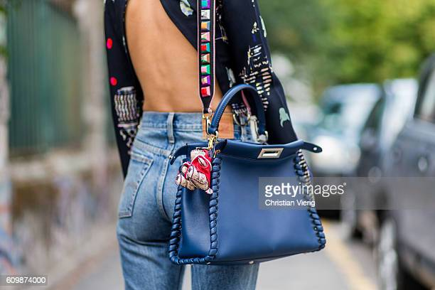 Lisa Hahnbeuck wearing Lala Berlin Backless Cropped Silk Top with Long Sleeves, jeans Levi's Wedgie, bag Fendi Peekaboo outside Fendi during Milan...