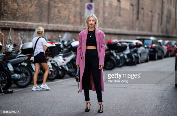 Lisa Hahnbueck cropped black top black cropped pants pink wool coat is seen outside Max Mara during Milan Fashion Week Spring/Summer 2019 on...