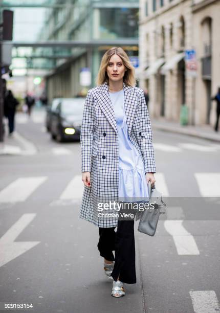 Lisa Hahnbueck is seen wearing a grey plaid Baum und Pferdgarten trench coat blue Baum und Pferdgarten dress a flared marrakesh mih jeans Gucci shoes...