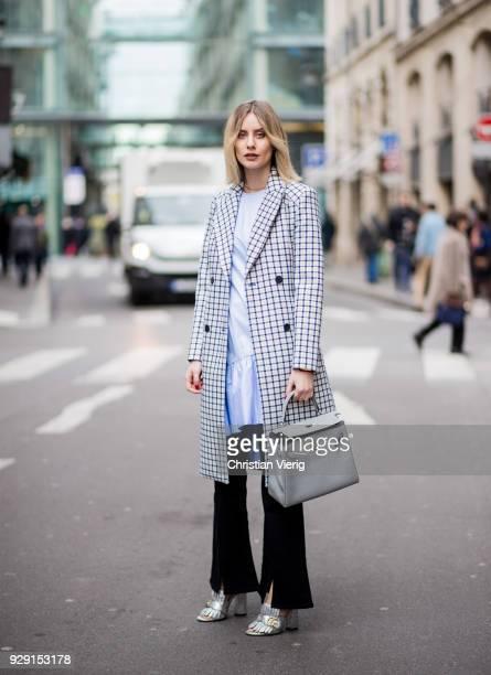 Lisa Hahnbueck is seen wearing a grey plaid Baum und Pferdgarten trench coat blue Baum und Pferdgarten dress a flared marrakesh mih jeans Gucci shoes...