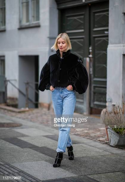 Lisa Hahnbueck is seen wearing black cropped Moncler jacket denim jeans Goldsign Jimmy Choo shoes during the Copenhagen Fashion Week Autumn/Winter...