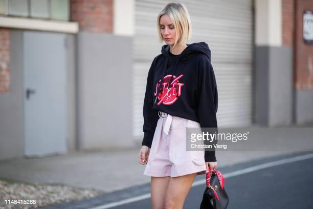 Lisa Hahnbueck is seen wearing black hoody Jet Set pink Isabel Marant shorts Hermes Kelly bag on May 05 2019 in Duesseldorf Germany