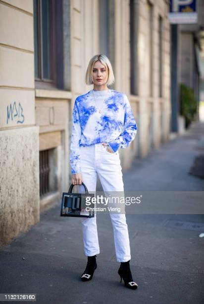 Lisa Hahnbueck is seen wearing blue jumper Balmain, white jeans Redone, Boyy bag, Roger Vivier velvet heels on Day 5 Milan Fashion Week Autumn/Winter...