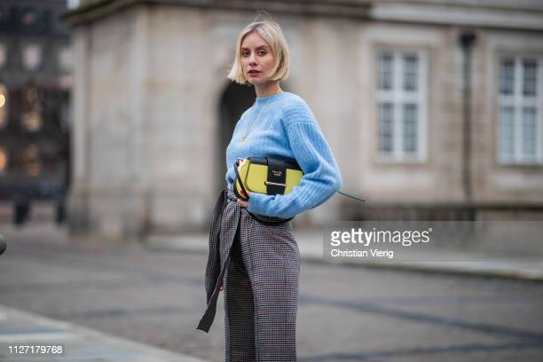 Lisa Hahnbueck is seen wearing blue other stories knit high waisted flared pants Silvia Tcherassi and Prada bag during the Copenhagen Fashion Week...
